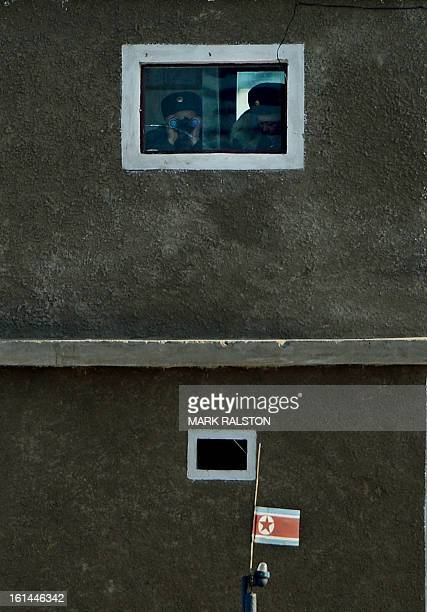 North Korean soldiers monitor the Yalu River from a guard tower at the North Korean town of Sinuiju on February 11 2013 across from the Chinese city...