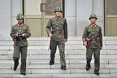 North Korean soldiers observe the South side as government delegations from the UN allied nations visit the truce village of Panmunjom in the...