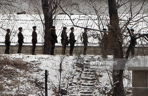 North Korean soldiers patrol along the Yalu River at the North Korean town of Sinuiju after the country conducted it's third nuclear test on February...