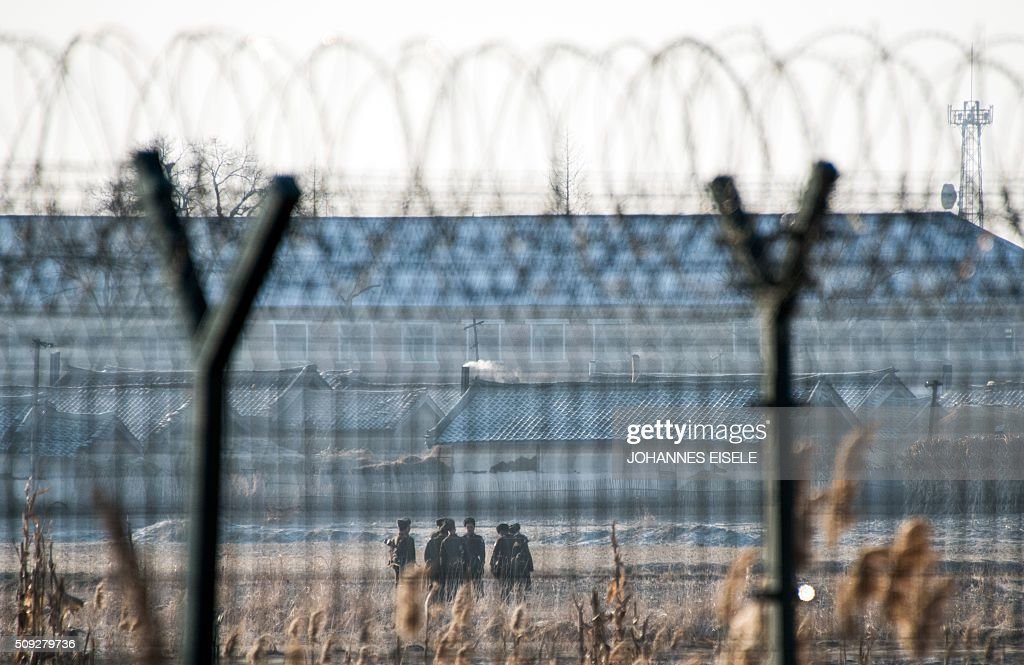 North Korean soldiers patrol next to the border fence near the town of Sinuiju across from the Chinese border town of Dandong on February 10, 2016. North Korea has restarted a plutonium reactor that could fuel a nuclear bomb and is seeking missile technology that could threaten the United States, Washington's top spy said. AFP PHOTO / JOHANNES EISELE / AFP / JOHANNES EISELE