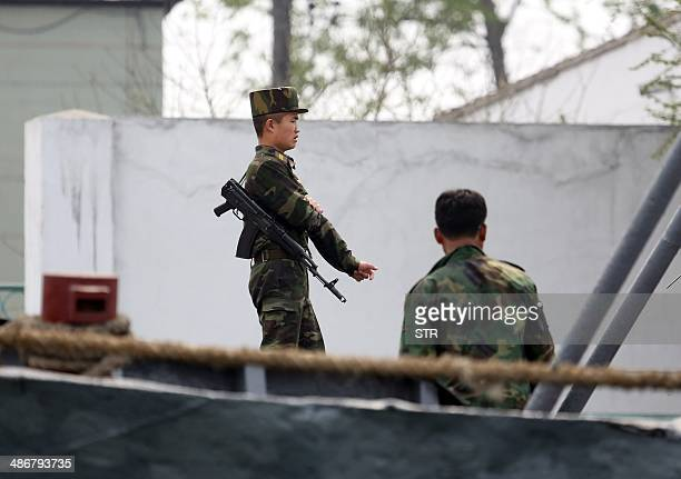 North Korean soldiers patrol the bank of the Yalu River which separates the North Korean town of Sinuiju from the Chinese border town of Dandong...