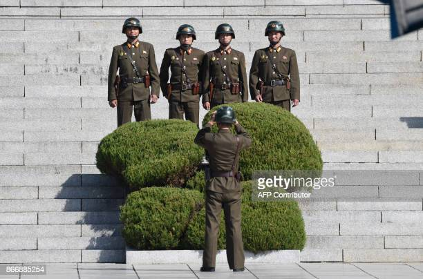 North Korean soldiers pose for a photo in the North side while US Secretary of Defence Jim Mattis and South Korean Defence Minister Song YoungMoo...