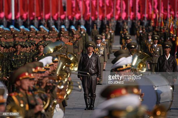 North Korean soldiers prepare for the start of a mass military parade at Kim IlSung square in Pyongyang on October 10 2015 North Korea was marking...