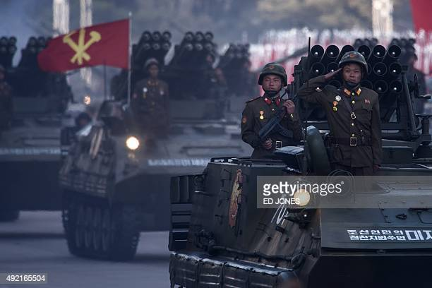 North Korean soldiers ride armoured personnel carriers as they participate in a mass military parade at Kim IlSung square in Pyongyang on October 10...