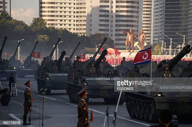 North Korean soldiers ride atop tanks during a mass military parade at Kim IlSung square in Pyongyang on October 10 2015 North Korea was marking the...