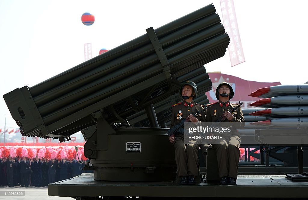 North Korean soldiers ride on the back of a MLRS (mutliple launch rocket system) during a military parade to mark 100 years since the birth of North Korea's founder Kim Il-Sung in Pyongyang on April 15, 2012. North Korea's new leader Kim Jong-Un delivered his first public speech on April 15 and vowed to push for 'final victory' for his impoverished state despite a failed rocket launch two days ago.