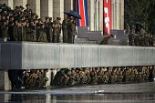 North Korean soldiers shelter from the rain beneath a balcony following a mass military parade in Pyongyang on October 10 2015 North Korea was...