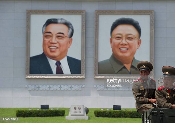 North Korean soldiers sit on the back of a truck on Kim IlSung square before portraits of former leaders Kim IlSung and Kim JongUn as they wait to...