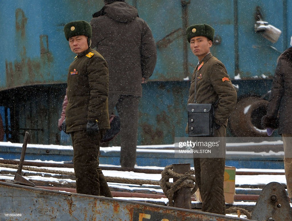 North Korean soldiers stand guard along the Yalu River at the North Korean town of Sinuiju on February 12, 2013 across from the Chinese city of Dandong. North Korea confirmed on February 12 it had 'successfully' carried out an underground nuclear test, drawing immediate condemnation from rival South Korea. AFP PHOTO/Mark RALSTON