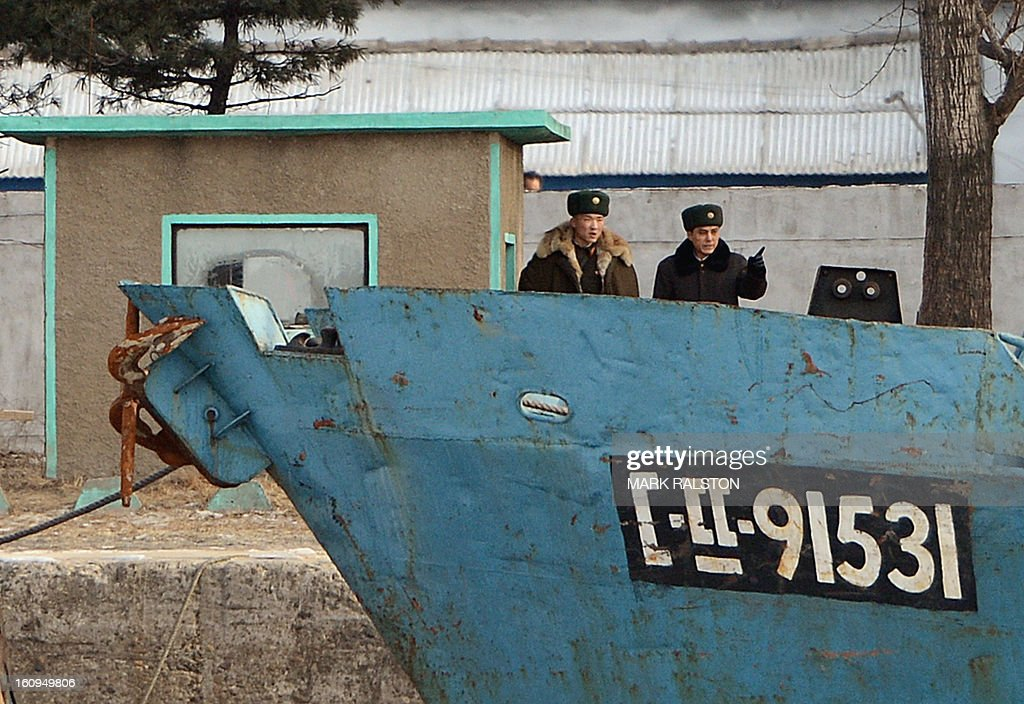 North Korean soldiers stand guard beside the Yalu River at the North Korean town of Sinuiju on February 8, 2013 which is close to the Chinese city of Dandong. US Secretary of State John Kerry warned that North Korea's expected nuclear tests only increase the risk of conflict and would do nothing to help the country's stricken people. The country has vowed to carry out a third nuclear test soon, and concerns have been raised over the type of fissile material used in the device. AFP PHOTO/Mark RALSTON