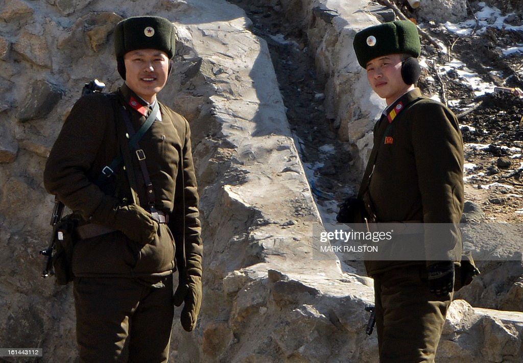 North Korean soldiers stand guard on the banks of the Yalu River at the North Korean town of Sinuiju on February 11, 2013 across from the Chinese city of Dandong. A North Korean state media outlet has accused the United States of 'jumping to conclusions' that the North would soon stage a nuclear test, adding to the confusion over its immediate intentions. The US and its ally South Korea are 'fussing over speculation' without knowing exactly what action the North plans to take, Tongil Sinbo, a Japan-based pro-North weekly magazine funded by Pyongyang, said. AFP PHOTO/Mark RALSTON
