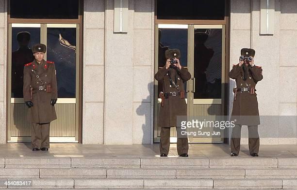 North Korean soldiers stand guards as US Vice President Joe Biden visit at Panmunjom on December 7 South Korea Vice President Biden has been visiting...