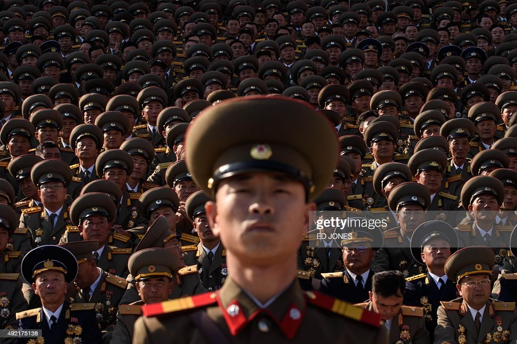 A North Korean soldiers stands before spectators during a mass military parade at Kim IlSung square in Pyongyang on October 10 2015 North Korea was...
