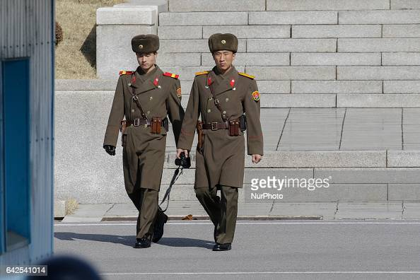 North Korean soldiers walk patrol around truce village at Panmunjom in Paju South Korea on February 18 2017