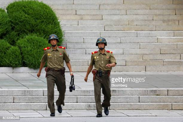 North Korean soldiers walk toward the southern side of the truce village of Panmunjom in the Demilitarized Zone in Paju South Korea on Thursday July...