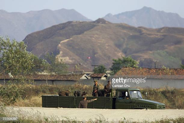 North Korean soldiers work on the outskirts of the North Korean city of Sinuiju in this picture taken on October 18 2006 in the Chinese border city...