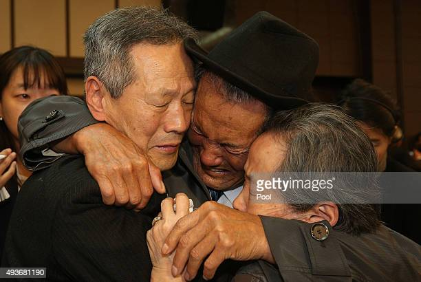 North Korean Son GwonGeun cries with his South Korean relatives as they bid farewell following their family reunion on October 22 2015 in Mount...