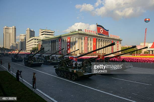 North Korean tanks pass through Kim IlSung square during a mass military parade in Pyongyang on October 10 2015 North Korea was marking the 70th...