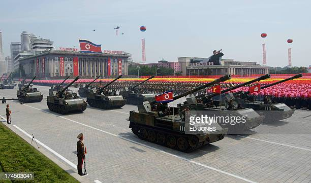 North Korean tanks pass through Kim IlSung square during a military parade marking the 60th anniversary of the Korean war armistice in Pyongyang on...