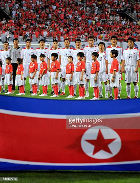 North Korean team players sing their national song in front of its flag before the 2010 FIFA World Cup qualifying football match against South Korea...
