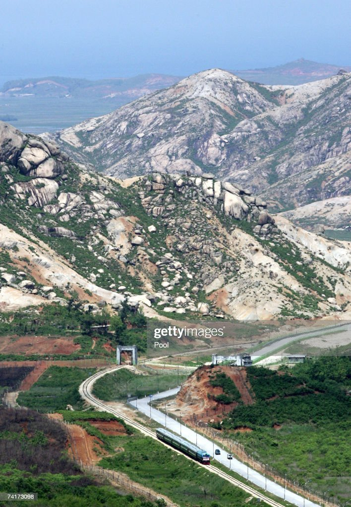A North Korean train passes through to the demilitarized zone in east cost railway on May 17 2007 in GoSeong South Korea Two trains set out in each...