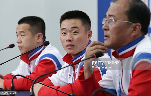 North Korean weightlifter gold medalists Om YunChol and Kim UnGuk attend the press conference during the 2014 Asian Games at Main Press Center on...
