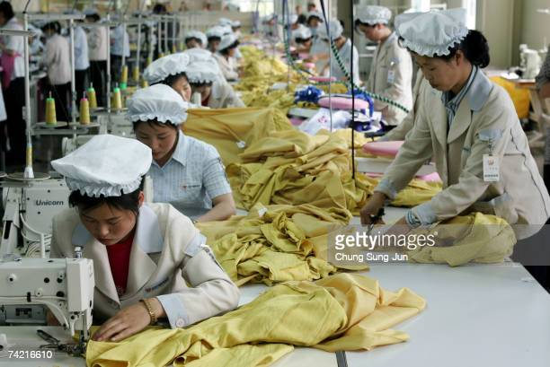 North Korean women work at the assembly line of the factory of South Korean textile company ShinWon at the Kaesong industrial complex on May 22 2007...