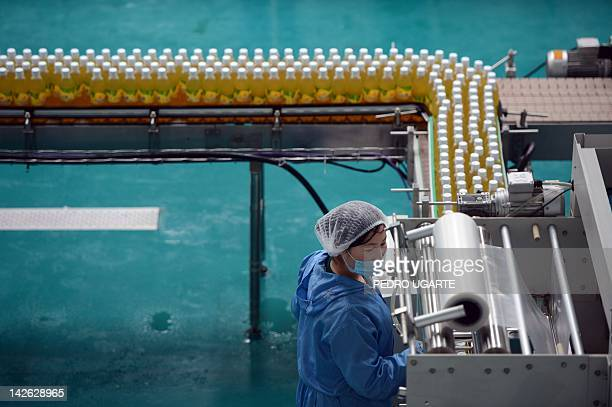 North Korean workers operate a fruit juice factory on the outskirts of Pyongyang on April 10 2012 North Korea is counting down to the 100th...