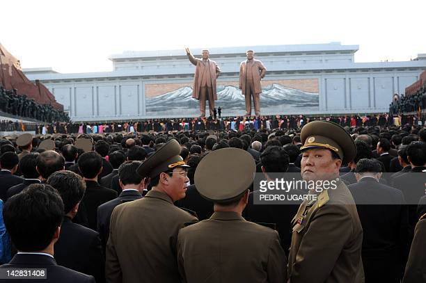 North Koreans attend the unveiling ceremony of two statues of former leaders Kim IlSung and Kim JongIl in Pyongyang on April 13 2012 North Korea's...