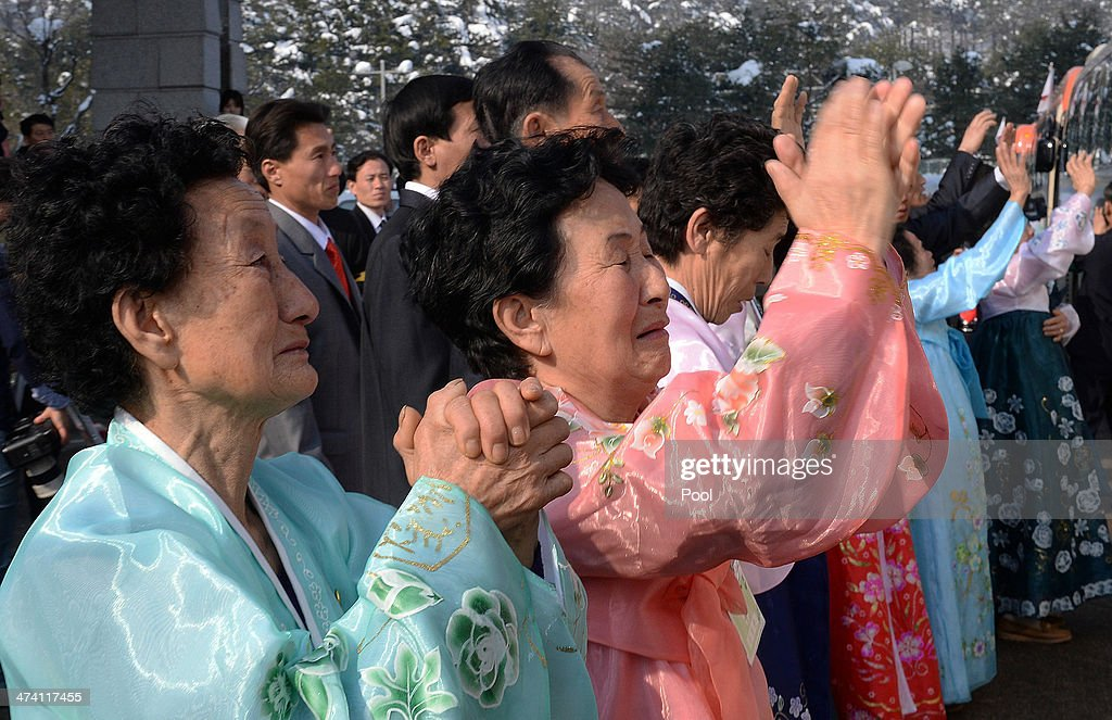 North Koreans bid farewell to their South Korean relatives before they return to their home after a family reunion having been separated for 60 years following the Korean War on February 22, 2014 in Mount Kumgang, North Korea. The program, which allows reunions of family members separated by the 1950-53 Korean war, is a result of recent agreement between North and South Korea which had been suspended since 2010.