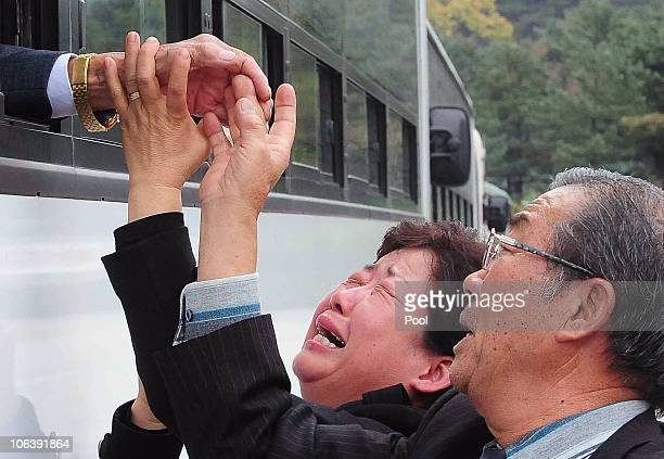 North Koreans in a bus bid farewell to their South Korean relatives during a family reunion after being separated for 60 years on October 31 2010 in...