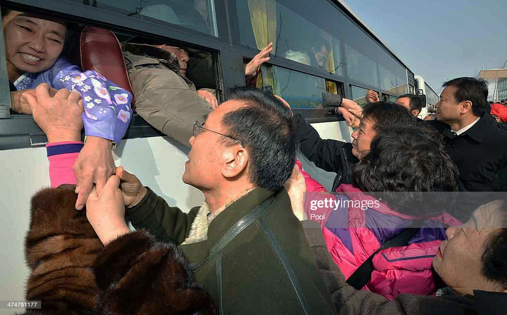 North Koreans in a bus bid farewell to their South Korean relatives before they return to their home after a family reunion, having been separated for 60 years following the Korean War on February 25, 2014 in Mount Kumgang, North Korea. The program, which allows reunions of family members separated by the 1950-53 Korean war, is a result of recent agreement between Koreas which had been suspended since 2010.