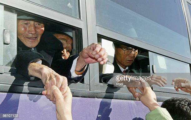 North Koreans in a bus bid farewell to their South Korean relatives after the 12th reunion since the two Koreas agreed to promote peace and...