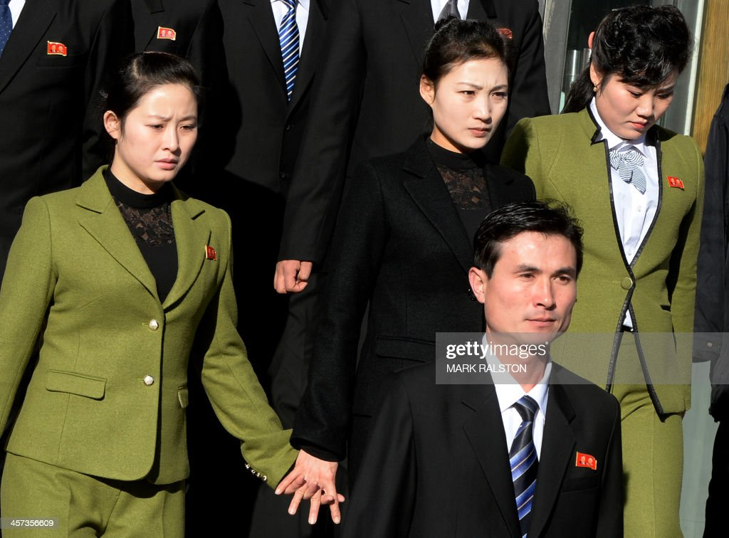 North Koreans leave the North Korean Consulate in the Chinese border town of Dandong after paying their respects during the second anniversary of the...