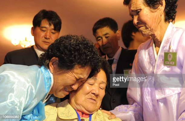 North Koreans Lim SamSook and Lim SamNyeo bid farewell to their South Korean sister Lim SaSil before they return to their home after a family reunion...