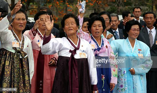 North Koreans wave to their South Korean relatives as they bid farewell after a threeday family reunion event at North Korea's Mount Kumgang resort...