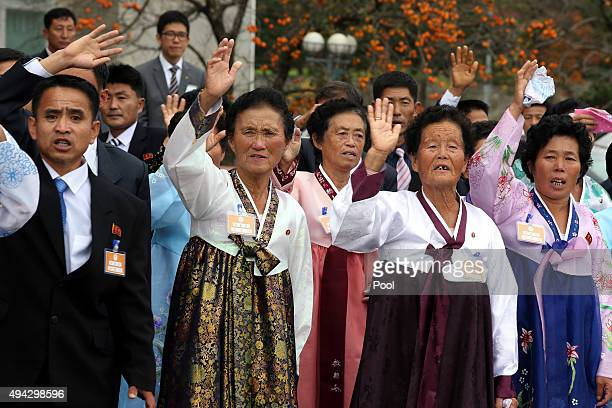 North Koreans wave to their South Korean relatives as they bid farewell before they return to their home after a family reunion having been separated...