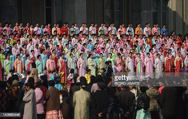 North Koreans women wearing traditional dresses rehearsal their show in streets of Pyongyang on April 11 2012 North Korea is counting down to the...