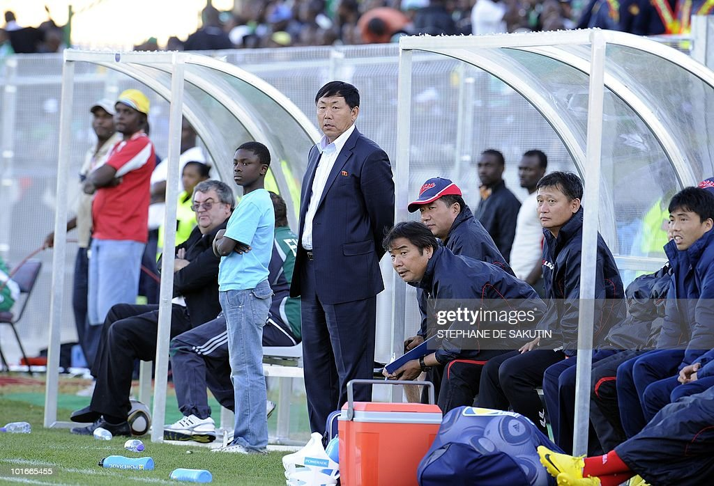 North Korea's coach, Kim Jong-Hun looks at his players during an international friendly football match against Nigeria at Makhulong stadium on June 6, 2010 in Tembisa . The 2010 FIFA World Cup football championship is due to take place in South Africa from June 11 to July 11 of 2010.