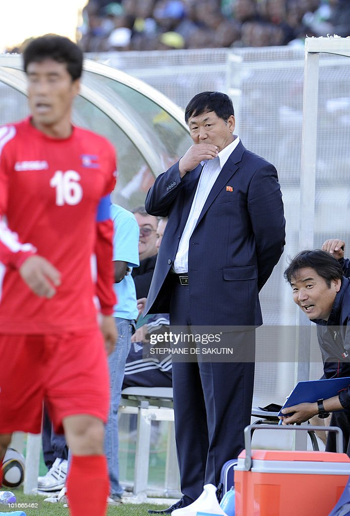 North Korea's coach, Kim Jong-Hun (R) looks at his players during an international friendly football match against Nigeria at Makhulong stadium on June 6, 2010 in Tembisa . The 2010 FIFA World Cup football championship is due to take place in South Africa from June 11 to July 11 of 2010.
