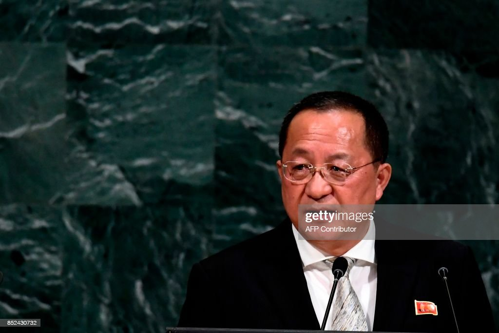 North Korea's Foreign Minister Ri Yong Ho, wearing a pin with images of North Korean leader Kim Jong-Un and his late father Kim Kim Jong-il, addresses the 72nd session of the United Nations General assembly at the UN headquarters in New York on September 23, 2017. / AFP PHOTO / Jewel SAMAD