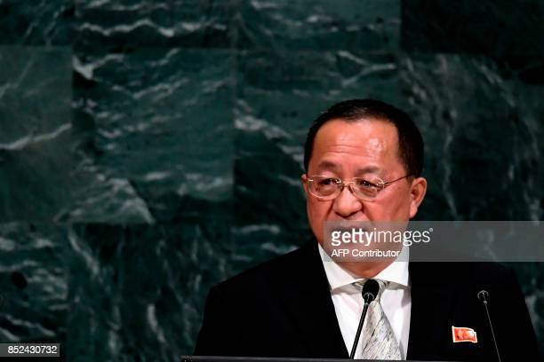 North Korea's Foreign Minister Ri Yong Ho wearing a pin with images of North Korean leader Kim JongUn and his late father Kim Kim Jongil addresses...