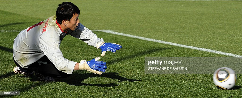 North Korea's goalkeeper, Ri Myiong-Guk blocks a ball during a training session prior an international friendly football match against Nigeria at Makhulong stadium on June 6, 2010 in Tembisa . The 2010 FIFA World Cup football championship is due to take place in South Africa from June 11 to July 11 of 2010.