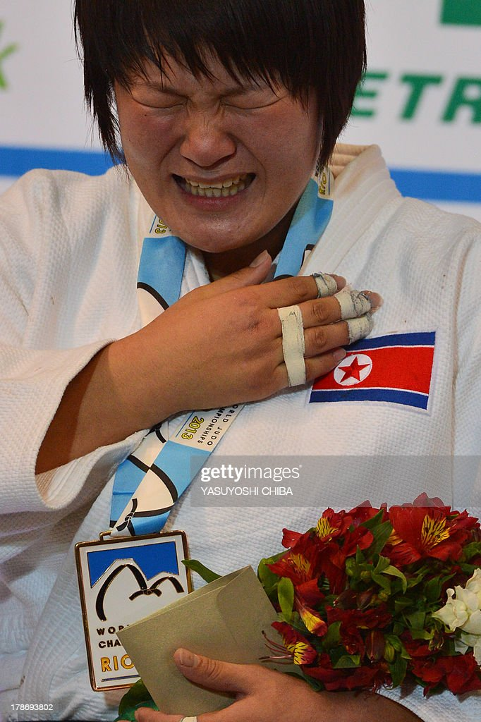 North Korea's gold medallist Kyong Sol cries on the podium during the medal ceremony for the women's -78kg category, during the IJF World Judo Championship, in Rio de Janeiro, Brazil, on August 30, 2013.