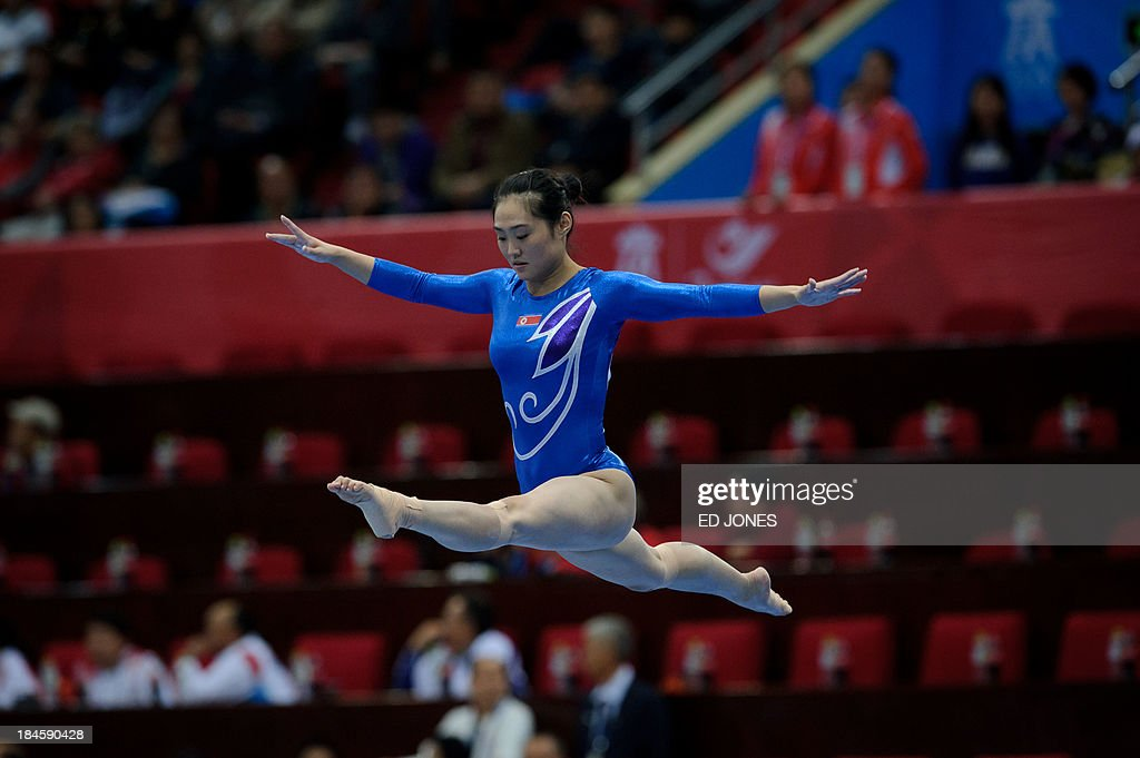 North Korea's Jong Hong Un competes in the women's Beam final event of the 6th East Asian Games in Tianjin on October 14, 2013. The eastern Chinese city is hosting the East Asian Games which sees nine countries participating in 262 events across 22 different sports. AFP PHOTO / Ed Jones