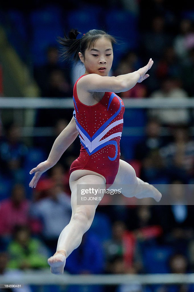North Korea's Kim Hyang Un competes in the women's Beam final event of the 6th East Asian Games in Tianjin on October 14, 2013. The eastern Chinese city is hosting the East Asian Games which sees nine countries participating in 262 events across 22 different sports. AFP PHOTO / Ed Jones