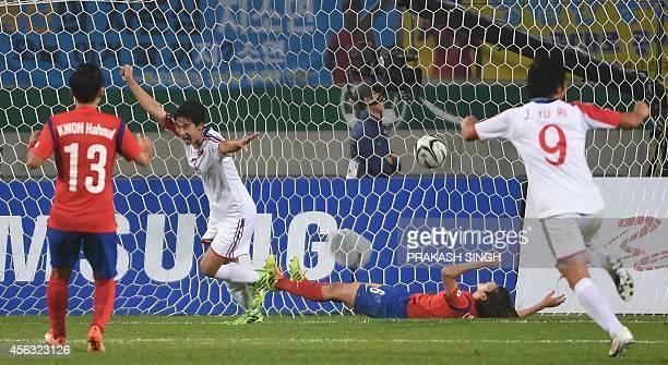 North Korea's Kim Hyeri celebrates a goal against South Korea during their women's football semifinal match of the 2014 Asian Games at the Munhak...