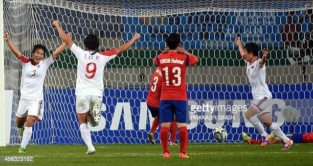 North Korea's Kim Hyeri celebrates a goal against South Korea with teammates during their women's football semifinal match of the 2014 Asian Games at...