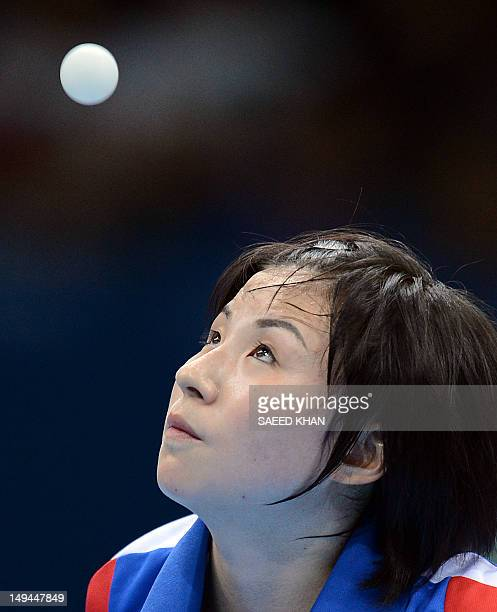 North Korea's Kim Jong returns a shot to Croatia's Cornelia Molnar during a table tennis women's singles preliminary round match of the London 2012...