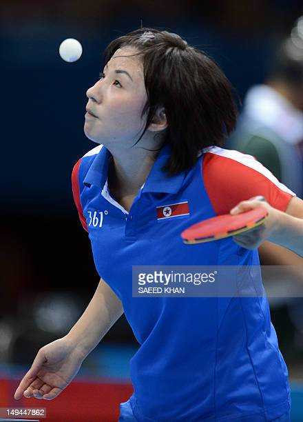 North Korea's Kim Jong serves to Croatia's Cornelia Molnar during a table tennis women's singles preliminary round match of the London 2012 Olympic...